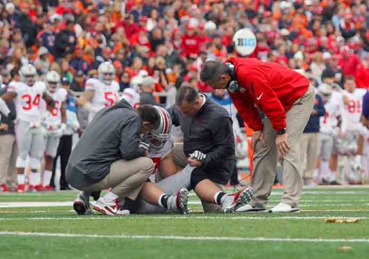 Freshman defensive lineman Joey Bosa (97) is looked at by the OSU training staff and coach Urban Meyer during a game against Illinois Nov. 16 at Memorial Stadium. OSU won, 60-35. Credit: Shelby Lum / Photo editor