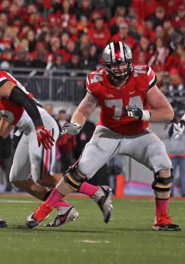Redshirt-senior left tackle Jack Mewhort (74) prepares to block a defender during a game against Penn State Oct. 26 at Ohio Stadium. OSU won, 63-14. Credit: Shelby Lum / Photo editor