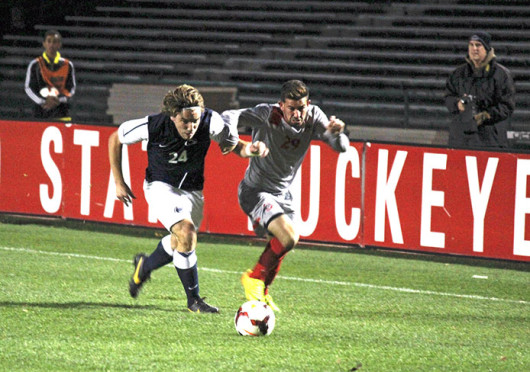 Junior midfielder Max Moller (29) attempts to beat his defender during a match against Penn State Nov. 2 at Jesse Owens Memorial Stadium. OSU won, 1-0. Credit: Sally Xia / Lantern photographer