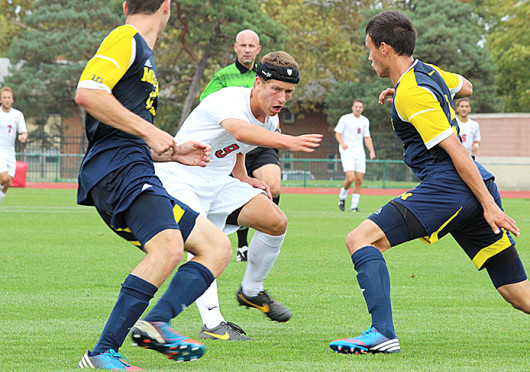 Freshman forward Danny Jensen (9) attempts to find an open teammate with a pass during a match against Michigan Oct. 6 at Jesse Owens Memorial Stadium. OSU lost, 1-0. Credit: Sally Xia / Lantern photographer