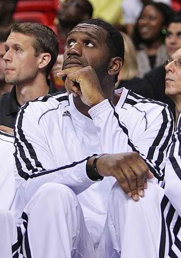 Miami Heat center Greg Oden watches from the bench during a preseason game against the San Antonio Spurs AmericanAirlines Arena Oct. 19. The Heat won, 121-96.