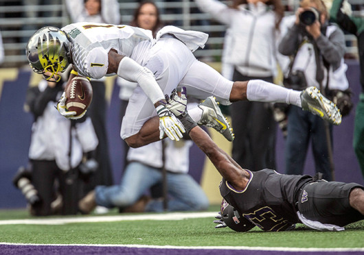 Oregon senior wide receiver Josh Huff (1) dives for the end zone during a game against Washington Oct. 12 at Husky Stadium. Oregon won, 45-24. Credit: Courtesy of MCT
