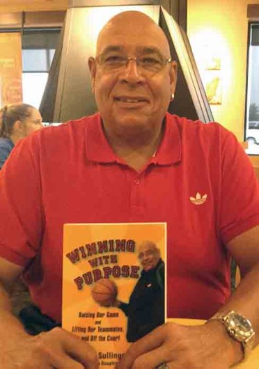 Satch Sullinger, father of former Buckeyes Jared and J.J. Sullinger poses with his new book 'Winning with Purpose.' Credit: Jason Morrow / Lantern photographer