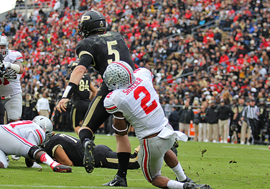 Junior linebacker Ryan Shazier (2) sacks the quarterback during a game against Purdue Nov. 2 at Ross-Ade Stadium. OSU won, 56-0. Credit: Shelby Lum / Photo editor