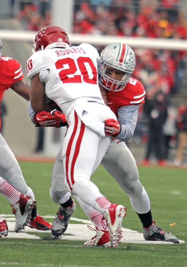 Junior linebacker Ryan Shazier tackles the running back during a game against Indiana Nov. 23 at Ohio Stadium. OSU won, 42-14. Credit: Shelby Lum / Photo editor