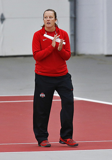 OSU women's tennis coach Melissa Schaub watches the Buckeyes during a match against Michigan April 21 at the Varsity Tennis Center. OSU lost, 7-0. Credit: Courtesy of the OSU Athletic Department