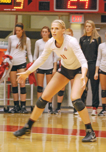 Senior outside hitter Kaitlyn Leary (11) gets set before a serve during a match against Illinois Nov. 22 at St. John Arena. OSU lost, 3-1. Credit: Tim Moody / Lantern reporter