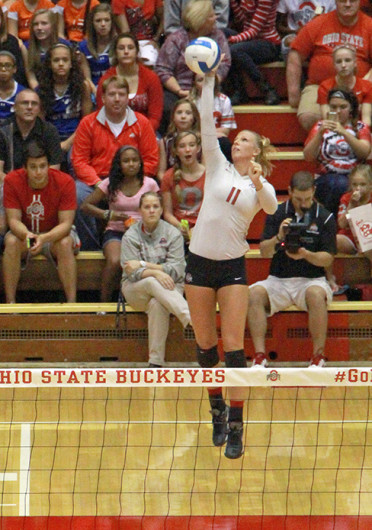 Senior outside hitter Kaitlyn Leary (11) serves the ball during a match against Michigan Sept. 27 at St. John Arena. OSU won, 3-1. Credit: Mark Batke / Lantern photographer