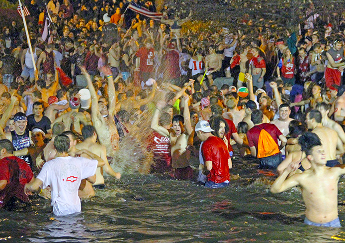 Ohio State fans jump in Mirror Lake as part of a Beat Michigan Week tradition in 2012. Credit: Daniel Chi / For The Lantern