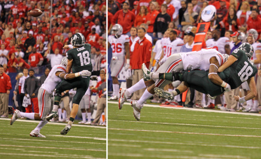 Junior linebacker Ryan Shazier (left) hits Connor Cook after he releases a pass during the Big Ten Championship Game Dec. 7 in Indianapolis. OSU lost, 34-24. Credit: Shelby Lum / Photo editor