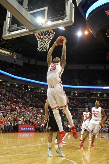 Junior center Amir Williams (23) dunks the ball during a game against Bryant Dec. 11 at the Schottenstein Center. OSU won, 86-48. Credit: Shelby Lum / Photo editor