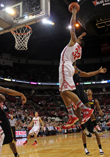 Senior guard Lenzelle Smith Jr. takes a shot during a game against Maryland Dec. 4 at the Schottenstein Center. OSU won, XX-XX. Credit: Kaily Cunningham / Multimedia editor