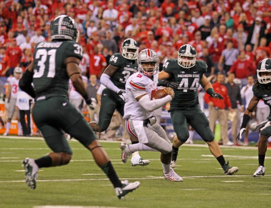 Junior quarterback Braxton Miller (5) is surrounded by Michigan State defenders during the Big Ten Championship Dec. 7 at Lucas Oil Stadium. OSU lost, 34-24.