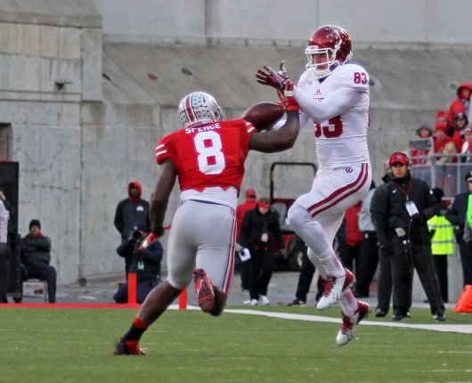 Sophomore defensive end Noah Spence (8) breaks up a pass during a game against Indiana Nov. 23. OSU won, 42-14. Credit: Shelby Lum / Photo editor