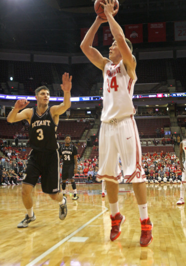 Junior forward Jake Lorbach (34) takes a shot during a game against Bryant Dec. 11 at the Schottenstein Center. OSU won, 86-48. Credit: Shelby Lum / Photo editor
