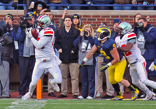 Freshman defensive back Tyvis Powell (23) intercepts an attempted two-point conversion during a game against Michigan Nov. 30 at Michigan Stadium. OSU won, 42-41. Credit: Shelby Lum / Photo editor