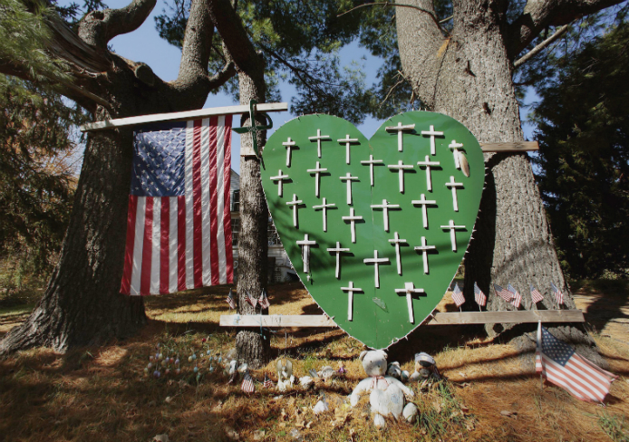 On Oct. 21, there are still signs around town of the grief felt after the shooting Dec. 14, 2012, in Newtown, Conn.