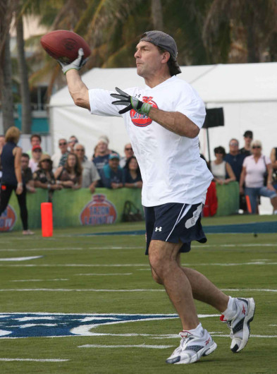 Former NFL player Doug Flutie  participates at the Tazon Latino IV at Lummus Park as part of the festivities of the SuperBowl XLIV. Credit: Courtesy of MCT