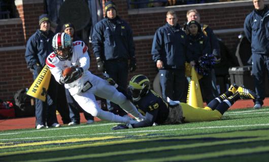 Junior quarterback Braxton Miller (5) scores a touchdown during a game against Michigan Nov. 30. OSU won, 42-41. Credit: Shelby Lum / Photo editor