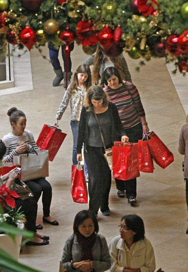 Shoppers laden with bags of sale items walk South Coast Plaza in Costa Mesa, Calif. Nov. 29.  Credit: Courtesy of MCT