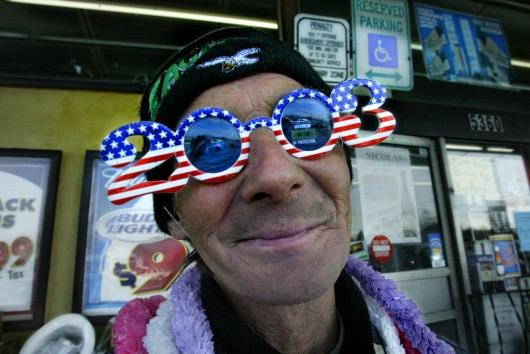 John White, of Camden, N.J., models the 2003 glasses he is selling at Canal's Discount in Pennsauken, N.J., Dec. 30, 2002. Credit: Courtesy of MCT