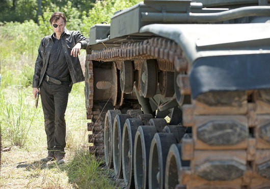 The Governor (David Morrissey) stands next to a tank before attacking the prison in the midseason finale of 'The Walking Dead.' Credit: Gene Page / AMC