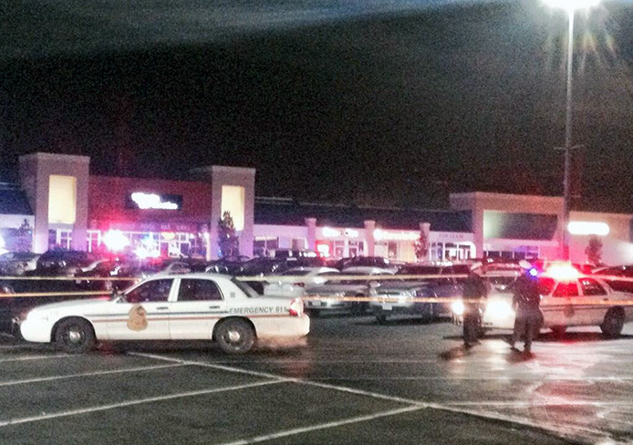 Columbus Division of Police cars sit outside Charlie Bear: Land of Dance, located at 2885 Olentangy River Road, Dec. 2 at about 2:30 a.m. A person was pronounced dead Dec. 2 after an officer-involved shooting at the club. Credit: Patrick Maks / For The Lantern