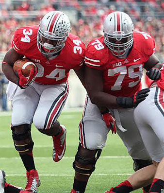Then-redshirt-junior right guard Marcus Hall (79) blocks for then-junior running back Carlos Hyde (34) during a game against Illinois Nov. 3, 2012, at Ohio Stadium. OSU won, 52-22. Credit: Lantern file photo