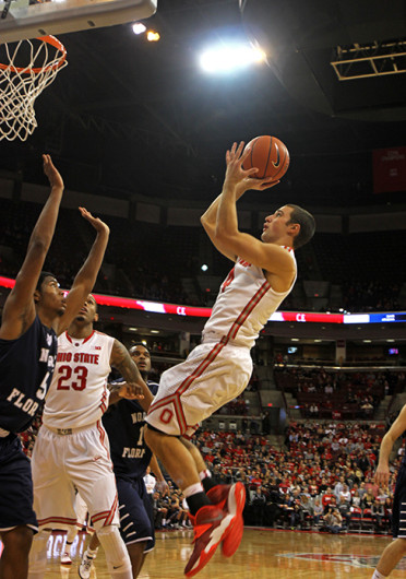 Senior guard Aaron Craft (4) attempts a jumper during a game against North Florida Nov. 29 at the Schottenstein Center. OSU won, 99-64. Credit: Shelby Lum / Photo editor
