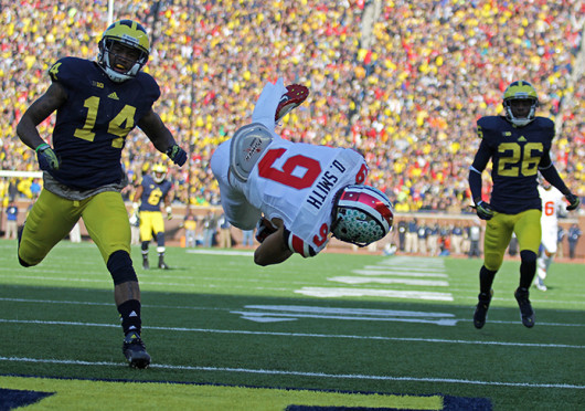 Junior wide receiver Devin Smith (9) dives into the end zone during The Game Nov. 30 at Michigan Stadium. OSU won, 42-41. Credit: Shelby Lum / Photo editor