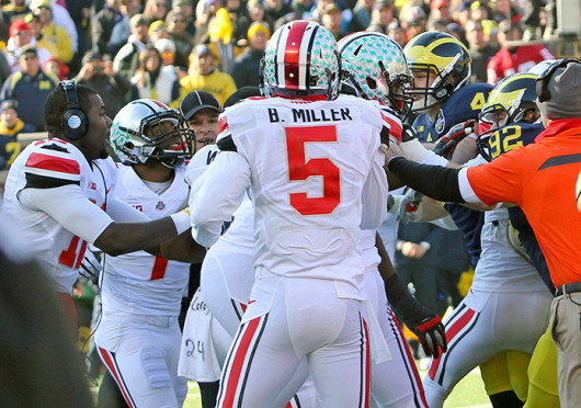 Dontre Wilson (1) and other Buckeye players fight with Michigan players during a game Nov. 30 at Michigan Stadium. OSU won, 42-41. Credit: Ritika Shah/ Asst. photo editor