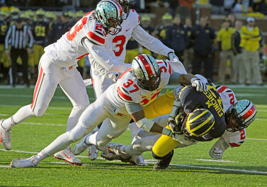 Sophomore linebacker Joshua Perry (37) tackles a player during The Game Nov. 30 at Michigan Stadium. OSU won, 42-41. Credit: Ritika Shah / Asst. photo editor