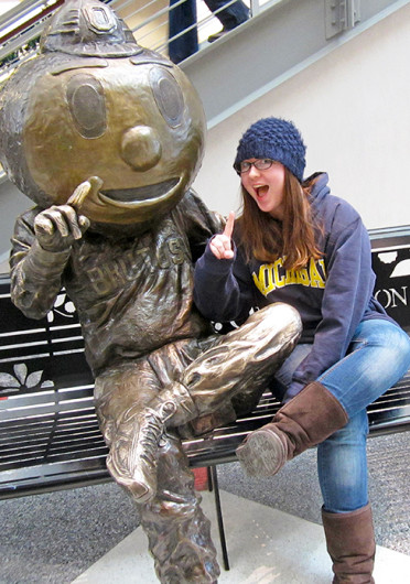 Posing with the Brutus Buckeye statue at the Ohio Union, Lantern reporter Kim Dailey spent her gameday during Rivalry Week posing as a Michigan fan on OSU's campus.
