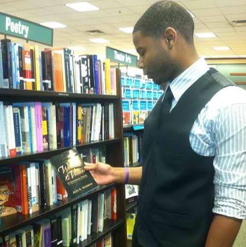 Ohio State graduate Alex Warren holds 'Wisdom & Vision: 70 Inspiring Poems on How to Live a Meaningful Life,' the book he authored, at a Barnes & Noble store. Credit: Courtesy of Alex Warren