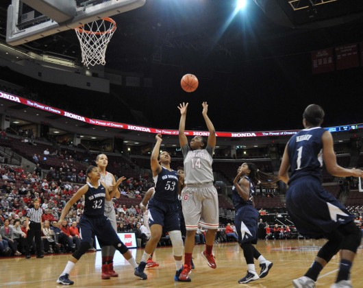 OSU sophomore guard Ameryst Alston (14) shoots the ball during a game against Old Dominion Nov. 22 at the Schottenstein Center. OSU won, 75-60. Credit: Liz Young / Campus editor