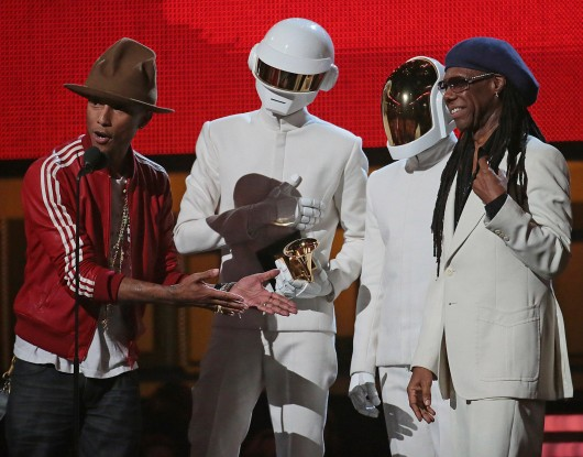 Pharrell Williams, Daft Punk and Nile Rogers on stage to accept the Grammy for Record of the Year at the 56th Annual Grammy Awards Jan. 26. Credit: Courtesy of MCT