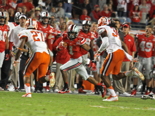 Freshman running back Dontre Wilson avoids defenders during the 2014 Discover Orange Bowl Jan. 3 at Sun Life Stadium. OSU lost, 40-35. Credit: Shelby Lum / Photo editor