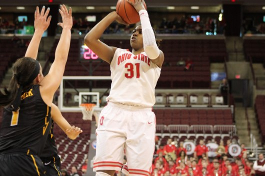 Junior guard Raven Ferguson (31) lines up for a shot. OSU lost against Iowa, 81-74, Jan. 19 at the Schottenstein Center. Credit: Ryan Robey / For The Lantern