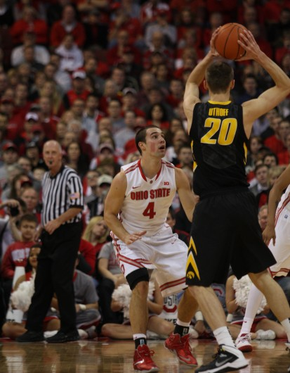 Senior guard Aaron Craft (4) defends and Iowa player during a game Jan. 12 at the Schottenstein Center. OSU lost, 84-74. Credit: Shelby Lum / Photo editor