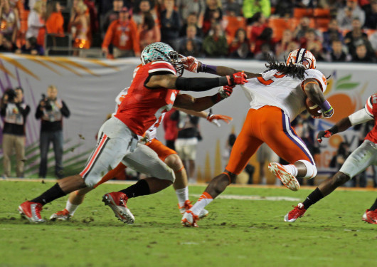 Junior wide receiver Sammy Watkins (2) pulls away as he runs with the ball. OSU lost against Clemson in the Orange Bowl Jan. 3, 40-35. Credit: Shelby Lum / Photo editor