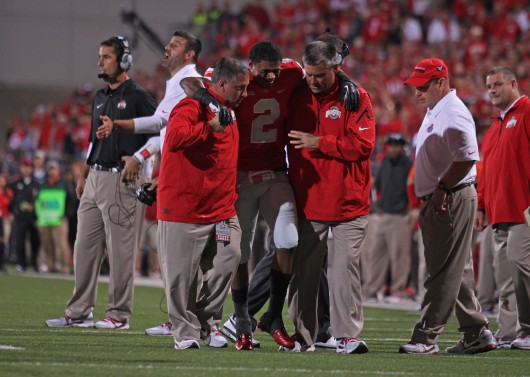 Senior safety Christian Bryant is helped off the field after breaking his ankle in a game against Wisconsin. OSU won, 31-24, Sept. 28 at Ohio Stadium. Credit: Shelby Lum / Photo editor
