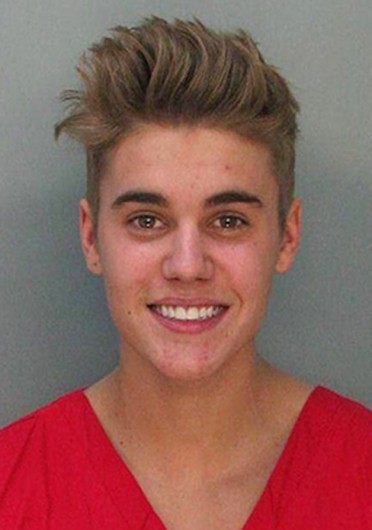Justin Bieber's mugshot. The singer was arrested early morning Jan. 23 for resisting arrest without violence, driving under the influence and driving with an expired license.