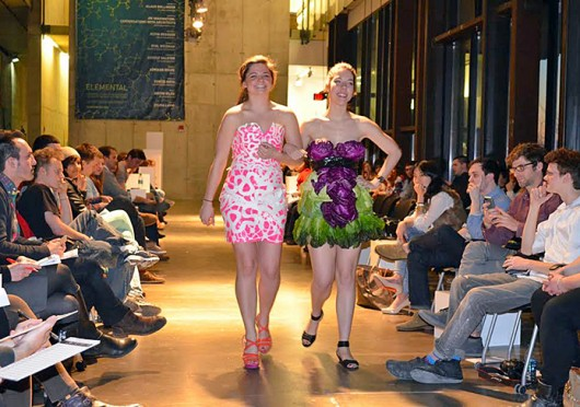 Kelsey Sellenraad (left) and Cheyenne Vandevode, both third-years in architecture, walk down the catwalk at the 2013 Fashion Schau at the Knowlton School of Architecture.  Credit:  Courtesy of Chris Mannella