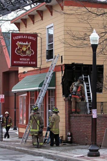 Firefighters work on a small fire at Cazuela's Grill that caused smoke damage Jan. 8. Credit: Ritika Shah / Asst. photo editor