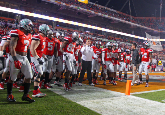 OSU players return to the field after halftime in the Orange Bowl against Clemson at Sun Life Stadium Jan. 3. OSU lost 40-35. Credit: Shelby Lum / Photo editor