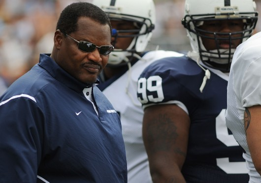 Collegian Photo By: David Walker Larry Johnson watches the team practice before the Blue and White scrimmage Saturday afteroon.