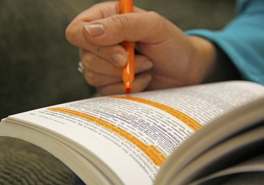 A student highlights a textbook. Some professors recently have encouraged their students to skim read assignments. Credit: Photo illustration by Ritika Shah / Asst. photo editor