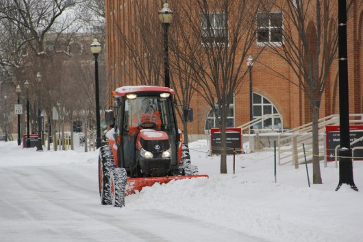A snow plow drives through campus to clear the road Jan. 26. Classes are set to  be canceled at OSU's Columbus campus Jan. 28. Credit: Ritika Shah / Asst. photo editor
