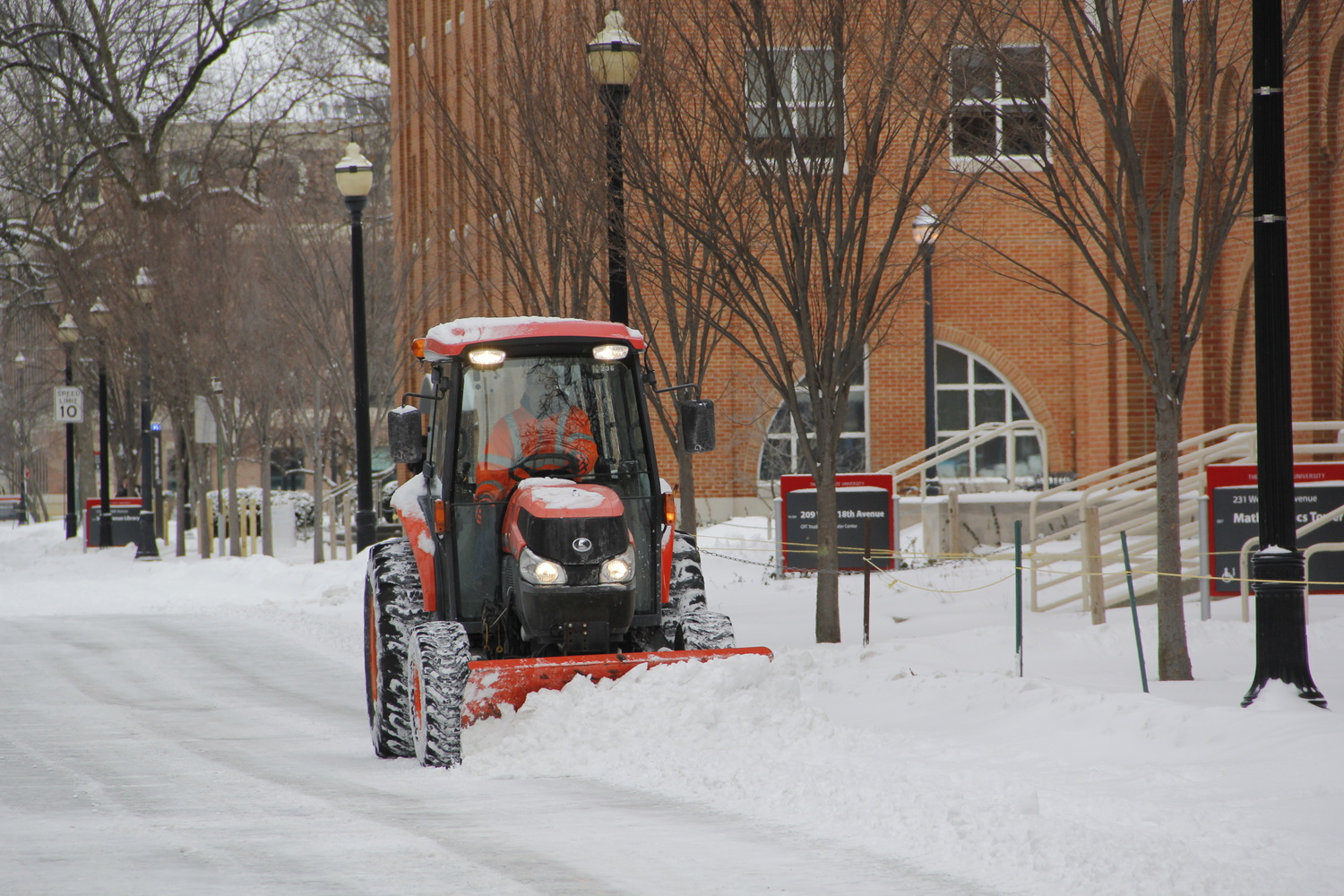 A snow plow drives through campus to clear the road Jan. 26. Classes were canceled at OSU's Columbus campus Jan. 28. Credit: Ritika Shah / Lantern TV News director