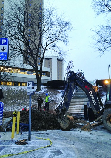 Crew members work to repair a water main break Jan. 22. Water services were shut off in Lincoln and Morrill Towers, the Drake Performance and Event Center and the Women's Field House for more than 5 hours.<br />Credit: Daniel Bendtsen / Senior Lantern reporter